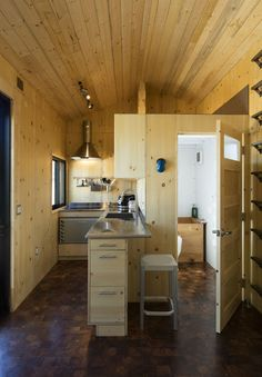 This is the SaltBox Tiny House on Wheels by Extraordinary Structures. It has just over 200 sq. of space and is built using a CNC-cut panelized construction system on a 24 foot trailer. Tyni House, House Made, Boat House, Tiny Cabins, Cabins And Cottages, Small Room Design, Tiny House Design, Santa Fe, Tiny House Movement
