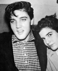 """Sandie Kaye Stevens took this picture of Elvis Presley and a fan, probably at the Beverly Wilshire Hotel, Beverly Hills, CA, 1958. Sandie had bought Elvis the checkered shirt which he really liked. She first met Elvis in 1957 when she was a 13-year-old extra on the set of """"Loving You"""" where she and Elvis became friends. © Sandie Kaye Stevens"""