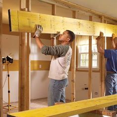Installing the beam is a two-person job