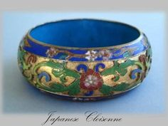 This Early Turn of the Century Japanese Cloisonne Bracelet shows a striking gold background which highlights the vibrant enamel colors beautifully.