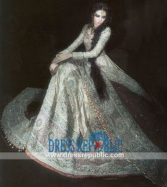 Pakistani Designer Mehdi Bridal Lehenga from 2013, 2014 Collection. Try this bridal gown extravagantly embellished with heavy floral and round motifs work. Buy online  from DressRepublic.com by www.dressrepublic.com