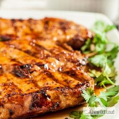 These Honey Mustard Grilled Pork Chops are tender and full of flavor. Tangy, sweet, and savory with a delicious sauce smothered over the grilled chops. Yum.