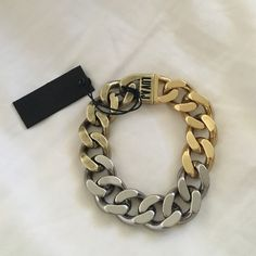 """NEW WITH TAGS! LUV AJ OMBRÉ CHAIN BRACELET Heavy metal chain bracelet, plated 3 different colors fades from one color to the next, for an ombre effect Magnetic clasp closure Bracelet is 7"""" around Nasty Gal Jewelry Bracelets"""