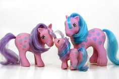 I adored My Little Ponies. I had a family like this one (green though) and the dad was my most coveted possession. He was the only dude pony I owned and everyone wanted him to be their boyfriend.     (You can tell a guy pony by his hairy feet. This is the same logic I used when playing GI Joes with my cousin. Any Joe that had with a face mask and pointed feet (vs feet in bulky boots) was deemed a girl and I'd play with it.)