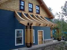 Curved Timber Frame Rafters. By Black Dog Timberworks, LLC