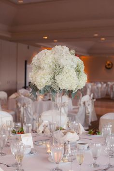 tall white hydrangea and babys breath wedding centerpiece flowers in clear vase white and Tall Wedding Centerpieces, Wedding Table Flowers, Candle Centerpieces, Wedding Flower Arrangements, Floral Centerpieces, Floral Wedding, Wedding Bouquets, Centerpiece Ideas, Trendy Wedding