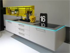 Cabinetry and countertops featured special lighting effects at imm cologne.