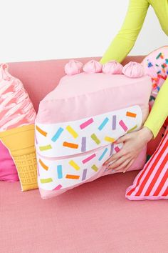 Diy No-Sew Funfetti Cake Slice Pillow - Who wouldn't want to come home and throw themselves in this fluffy and vibrant pillow. It will make you cheerful just by looking at it, so why not give yourself a little treat and get this easy diy project done right away. Plus it is so cool that it might even serve as a toy for the kids.