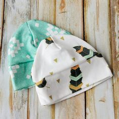 I am so loving all the sewing for baby cuteness, so I made one more free  pattern for you! An adorbs Baby Hat Sewing Pattern! It comes in sizes  preemie through 12 months so it is perfect for infants and big babies.  This cute little baby cap is made out of soft knit fabric and comes with a
