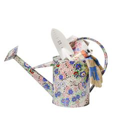 saw a similar floral watering can at target for 1/2 the price, I did this with a basket for Easter, adorable. also for Mother's Day