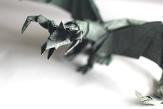 Origami Darkness Dragon (Tadashi Mori) - Published on May 7, 2012 Darkness Dragon 2.0 here: http://www.youtube.com/watch?v=sMRzP1...  Like my fanpage on Facebook to be the first to know what my next video will be! http://www.facebook.com/TadashiOrigami  Darkness Dragon Tutorial, by: Tadashi Mori http://www.youtube.com/tadashimori http://www.flickr.com/photos/tadashio...  CP: http://www.oritube.com.br/darkness%20...  Comparing with ancient dragon: http://www.flickr.com/photos/tadash