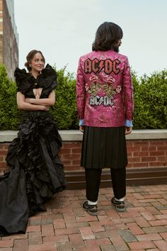 """On their way to tonight's Met Gala in New York, Dakota Johnson in a Gucci custom black silk moiré gown, and creative director Alessandro Michele in a Gucci custom jacquard jacket with AC/DC and pomegranate flower embroideries. In an homage to Rei Kawakubo he completed his look with a Comme des Garçons black pleated skirt and trousers. The gala marks the opening of the exhibit """"Rei Kawakubo/Comme des Garçons: Art Of The In-Between."""""""