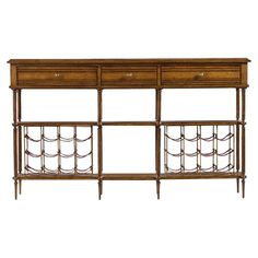 Stow favorite vintages in your dining room or home bar with this stylish sideboard, featuring 24 leather wine slings and antique-inspired details.