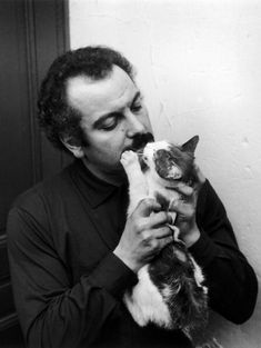Georges Brassens and cat en 1956