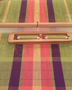 "I am besotted with this Maysville 8/4 cotton rug warp, which are basically leftovers from the baby blankets. Here I have warped a 24"" Ashford-type rigid heddle. I ran the yarn double through a 10-dent reed. The purple weft is the hem, which I wove as a single. The light green weft is being run doubled. There should be 78"" of weaving length that should get me two towels, approximately 20""  wide and 39"" long before hemming and washing. What type of towels, I have no idea!! #feistyhandwovens…"