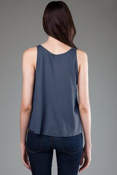 BP - 4SMMJ229 - Back - Azul -- eco-HYBRID™ Micro Jersey High Neck Tank. The higher neckline on this tank is perfect for printing. Made in USA. • Sizes: S-L, 3.7 oz., Eco-Hybrid™ Micro Jersey. • Garment dyed and washed, preshrunk, heavenly soft, feather-light feel and fantastic drape. • Single-needle stitching at neck and armholes.