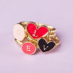 Spell out your love with these sweet and playful rings.