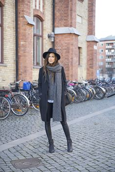 For a stunning winter style, why not wear various dark shades of grey and black and copy Anna Ericsson's elegant look! Consisting of a thick overcoat, a pair of leather leggings and a chunky knit scarf, this look is the perfect choice for those colder days! Brands not specified.