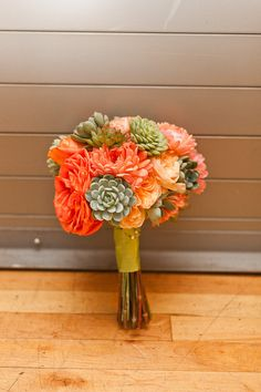 Remember the succulents in the floral arrangments. Orange and Succulent bouquet by Pennington Flowers, Southhampton, NY - photo by Sweet Little Photographs     LOVE Succullents, don't care how popular they are now.