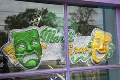 Green and yellow sign for Mardi gras with masks of comedy and drama - Mary Kate Denny/Photographer's Choice/Getty Images