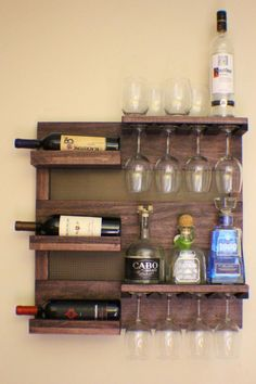 rustic dark cherry stained wall mounted wine rack with shelves and decorative mesh wine and