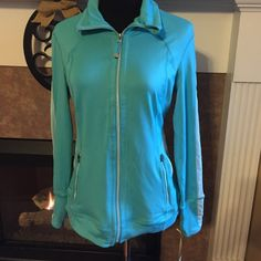 NWT turquoise jacket size small New with tags size small performance jacket by tangerine. So cute. Turquose. Great for everyday, working out, yoga, or the runners out there. Smoke free home. Has zipper closure, zippered pockets, inside pockets, and breathable panels. Tangerine Jackets & Coats Utility Jackets