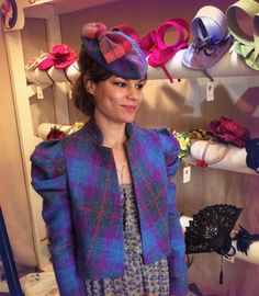 At the shop, 175 Portobello Road - customer wearing Sara Tiara purple Harris Tweed bolero and matching hat. #HarrisTweed #PurpleHarrisTweed #HarrisTweedTartan #TweedBolero #PuffSleeves #SaraTiara #PortobelloRoad #HarrisTweedHat