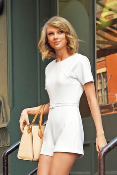 House of Ollichon loves...Taylor Swift in playful white jumpsuit. #celebrity #fashion #jumpsuit