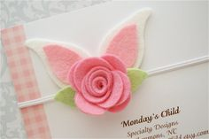 Adorable little bunny ears for Easter! Soft wool blend felt has been used to make the ears and the pink rose! The bunny ear headband measures 3
