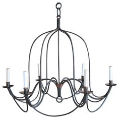 Large Provincial Style Wrought Iron Chandelier   From a unique collection of antique and modern chandeliers and pendants  at https://www.1stdibs.com/furniture/lighting/chandeliers-pendant-lights/