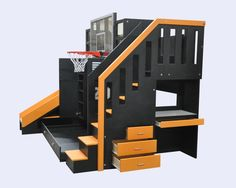 The Ultimate Basketball Bunkbed includes a desk w' pencil drawer and built in storage drawers on the side of the staircase. Click to see more.