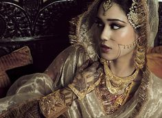 Tikki headguarment also known as Jhoomar are traditional Indian jewels worn on top of the head.