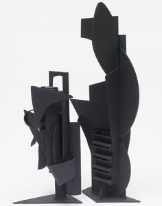 Louise Nevelson- Well it's all black s oit ties into unity, but withthe oval like pieces, it makes the sculpture appear as if it is winding, alomst like a staircase.