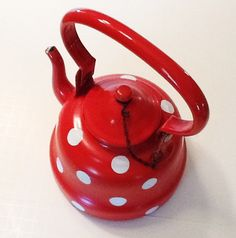 Red teapot, white polka dots, enamelware, from Yugoslavia.