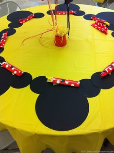 Homemade Mickey Mouse Place mats, or just black plates.  Red, yellow and white colored cutlery
