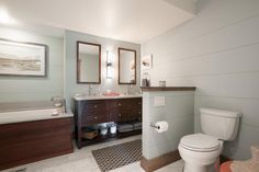 The double vanity offers tons of storage for guests.