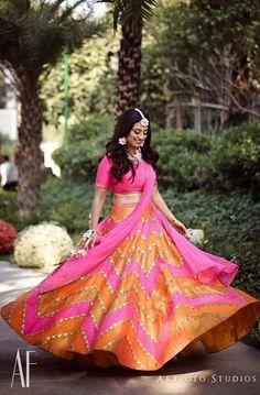 This fuschia and orange lehenga is apt for a mehendi function. #lehenga #bride #mehendilehenga #mehendioutfit #mehndi #multicolouredlehenga #mehndioutfitstyle #weddinginspiration #weddinginspo #bridestyle #bridegoals #shaadisaga #bridestyle #weddingoutfit #bridesofindia #ethnicwear Mehndi Outfit, Sangeet Outfit, Mehndi Dress, Mehendi, Garba Dress, Indian Bridal Outfits, Indian Dresses, Indian Clothes, Orange Lehenga