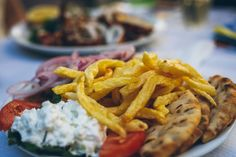 Learn how to make and prepare the recipe for Greek style fries topped with gyro ingredients. Greek Gyros, Gyro Recipe, Greek Dishes, Fries Recipe, Calamari, Lentil Soup, Greek Recipes, Food Plating, Potato Recipes