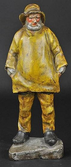 Full figure, -Eastern Specialty Co.,- depicting New England sea-faring icon on black base, done in traditional yellow raincoat & hat.