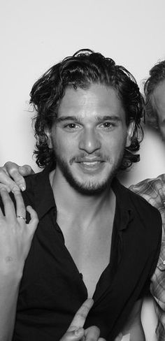 Kit Harrington. Mmmmm, sex-y. Here, can I help you undo the other buttons? ;)