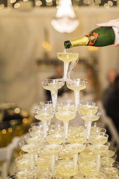 Champagne tower at Roaring 20's wedding. @weddingchicks