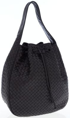 A Bottega Veneta Intrecciato woven leather hobo bag in black, with a drawstring and beige suede interior.