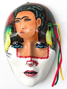 high x wide. Beautiful handpainted ceramic wall mask depicting Mexico's most famous artist Frida Kahlo. Each one is unique and has been signed by the artist who painted it. Handcrafted with love in Mexico. Most Famous Artists, Hand Painted Ceramics, Exotic, Artisan, Mexico, Unique, Wall, Masks, Painting