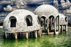 THE 50 STRANGEST ABANDONED PLACES BY STATE 9. Florida - The Dome Houses of Cape Romano Yes, there are a lot of strange abandoned places in Florida, but none are quite as odd as the random Dome Houses by Cape Romano. Their origin is a complete mystery to some, but they definitely have some strange architecture. You're not going to find structures like this anywhere else.