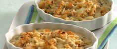 Try a French classic - scallops in a creamy wine sauce, topped with breadcrumbs, cheese, then browned under a broiler.