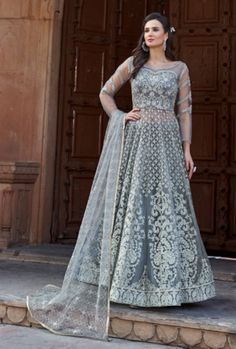 Stunning grey designer lehenga style suit online which is crafted from net fabric with exclusive embroidery and hand work. This stunning designer lehenga style suit comes with banglori silk bottom, net dupatta and japan satin, american crepe inner. Lehenga Choli Designs, Long Choli Lehenga, Anarkali Lehenga, Silk Lehenga, Anarkali Suits, Lehenga Suit, Lehnga Dress, Ghagra Choli, Indian Lehenga