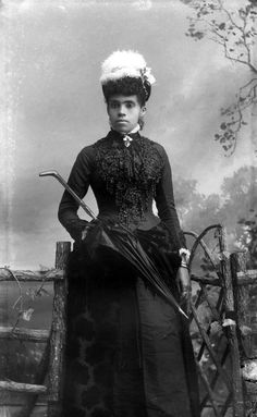 A young woman in a beaded dress and feathered hat (ca.1885-1910). | Florida Memory