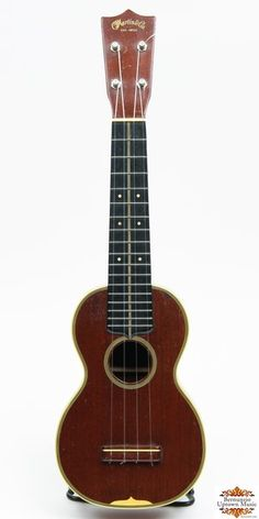 This vintage Martin ukulele features an all mahogany body with 10 ply binding around the top and soundhole. 17 fret ebony fingerboard with ivoroid dots and a binding stripe down the center. A thoroughly professional, and very clean uke. There are very slight, grain related surface cracks on the back and and the center cross brace has been replaced. Some playing wear on the upper bout, treble side.  Nice wide fingerboard, exceptional player. Included in the sale is the original hard case