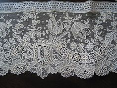 """Real Handmade Point de Gaze Lacebelow: (notice the header or strip across the top)   Tip: Handmade laces, and especiallytrims, often have a """"header"""" so they could be detached from clothing more easily for cleaning separately. Machine lace trims will sometimes have a header, but not commonly. Some handmade laces have had the header removed, so this isn't fool proof, but it's stilla good clue."""