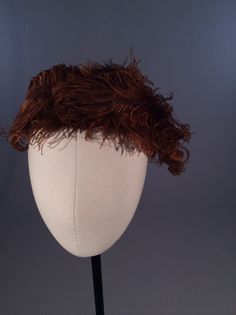 1950s sienna curled feather hat